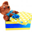 Yellow gift box with toy isolated on white — Stockfoto