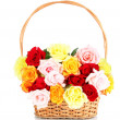 Beautiful bouquet of roses in wicker basket isolated on white — Stock Photo #26492957