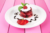 Tasty jelly dessert with fresh berries, on color wooden background — Stock Photo