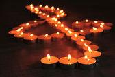 Burning candles as treble clef on dark background — Stock Photo