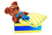 Yellow gift box with toy isolated on white — Stock Photo