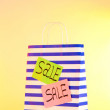 Striped bag on yellow background — Stock Photo