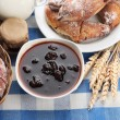 Stock Photo: Taste croissants, milk and jam, on tableclot