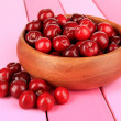 Royalty-Free Stock Photo: Cherry berries in bowl on wooden table close-up
