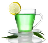 Transparent cup of green tea with lemon, isolated on white — Stock Photo