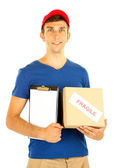 Young delivery man holding parcel and clipboard, isolated on white — Stock Photo