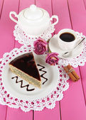 Delicious poppy seed cake with cup of coffee on table close-up — Stock Photo