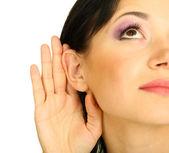 Girl overhears on grey background — Stock Photo