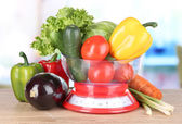 Fresh vegetables in scales on table in kitchen — Stock Photo