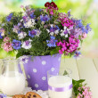 Beautiful bouquet in pail on wooden table on natural background — Stock Photo