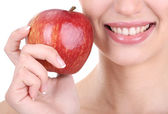 Smiling woman with apple close up — Stock Photo