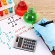 Stock Photo: Hand scientist writing formulas