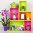 Beautiful colorful shelves with different home related objects — Stock Photo #26591821