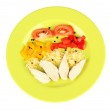 Preparing chicken stir fry with vegetables and spices on color plate, isolated on white — Stock Photo