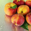Peaches on metal green background — Стоковое фото #26594179