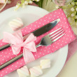 Table setting in white and pink tones on color wooden background — Stock Photo