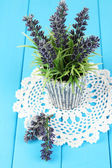 Decorative lavender in vase on blue wooden table close-up — Stock Photo