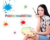 Piękna młoda kobieta malarz z pędzlami i palety, na białym tle — Zdjęcie stockowe