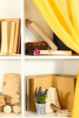 Many books on white shelves — Stock Photo