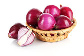 Purple onion in wicker basket isolated on white — Stock Photo