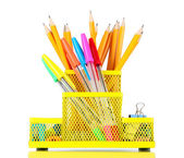 Office equipment in yellow stationary holder isolated on white — Stock Photo