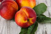 Peaches on wooden table — Stock Photo