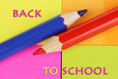 Pencils on color stickers background — Stock Photo