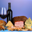 Exquisite still life of wine, cheese and meat products — Stock Photo #26601497