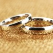 Stock Photo: Wedding rings on bright background