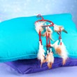 Beautiful dream catcher and pillows on blue background — Stock Photo #26602843