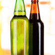Stock Photo: Bier in bottles on table on room background