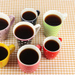 Many cups of coffee on checkered napkin — ストック写真