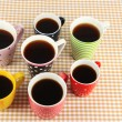 Many cups of coffee on checkered napkin — Stockfoto