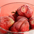 Frozen strawberries in bucket of ice on red background — Stock Photo #26607601