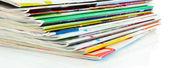Many magazines isolated on white — Stock Photo