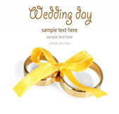 Wedding rings tied with ribbon isolated on white — Stock Photo