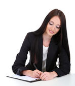 Young business woman writing, isolated on white — Stock Photo