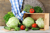 Composition of vegetables on table on wooden background — Stock Photo