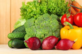 Fresh vegetables on wooden background — Stock Photo
