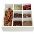 Assortment of aroma spices in white wooden box isolated on white — Stock Photo #26683113
