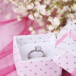 Engagement ring on pink cloth — Stock Photo