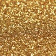 Decorative gold background with sparkling — Stock Photo