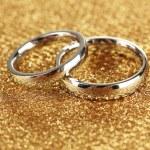 Wedding rings on bright background — Stock Photo