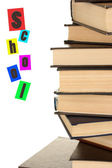 Tower of books on white background close-up — Stock Photo