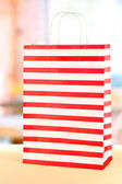 Striped bag on light background — Stock Photo