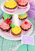Delicious beautiful cupcakes on festive table close-up — Stock Photo