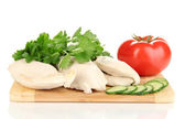 Boiled chicken breast on wooden cutting board with vegetables isolated on white — Stock Photo