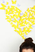 Paper yellow butterflies fly thoughts out of head — Stock Photo