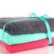 Towels tied with ribbon isolated on white — Stock Photo