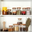 Variety spices on kitchen shelves — Stock Photo #26722909